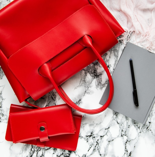 Red leather bag and accessories Premium Photo