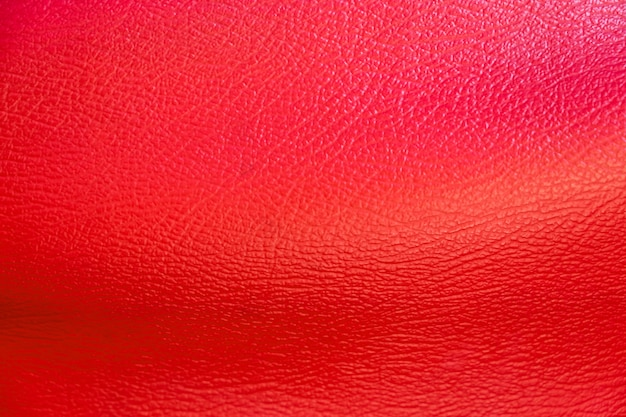 Red leather surface for background. shoes and handbag material Premium Photo