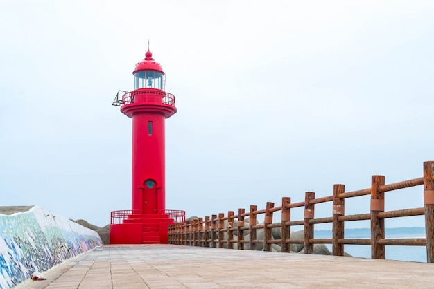 Red lighthouse in jeju island Premium Photo
