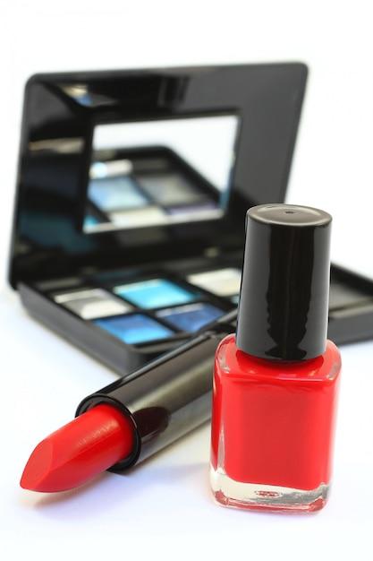 Red lipstick and nail polish isolated over white Premium Photo