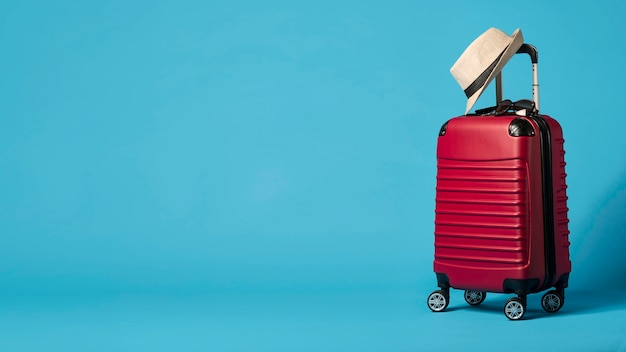 Red luggage with copy-space Free Photo