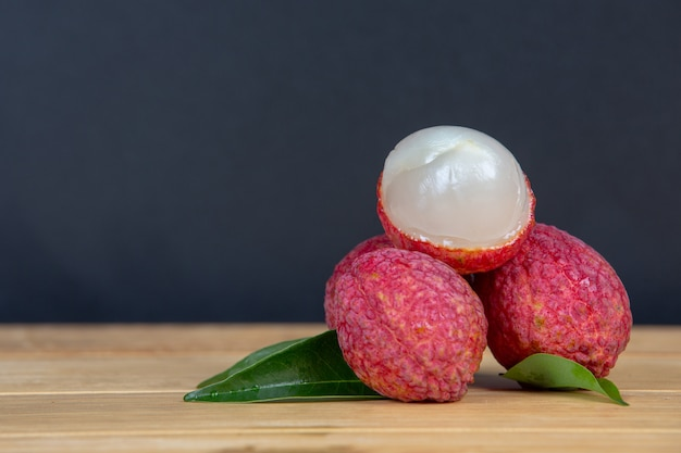 Red lychee fruit placed in a basket. Free Photo