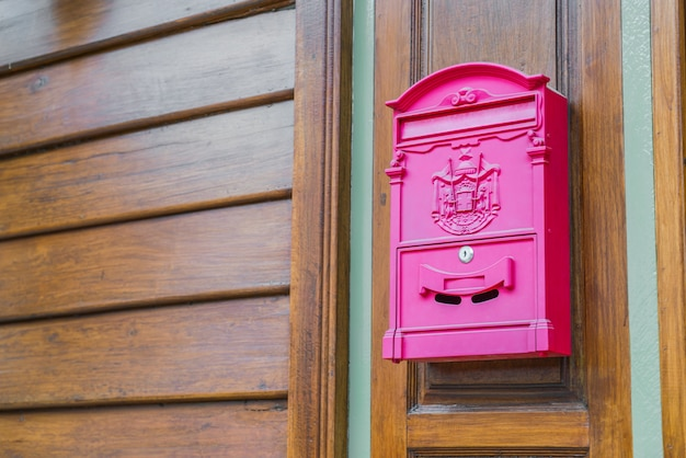 Red mail box on wood wall Free Photo
