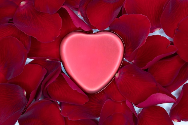 Red metal heart and red rose petals Photo   Premium Download