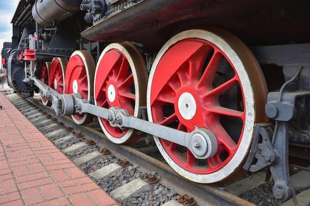 Red metal wheels, two wheels of steam locomotive, iron wheels Premium Photo