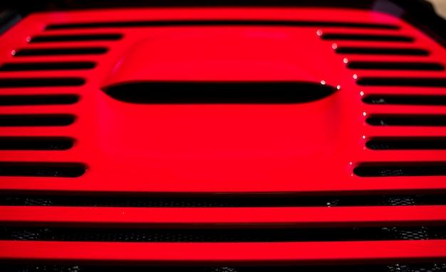 Red metallic sport car air conditioning, motor hence. Free Photo