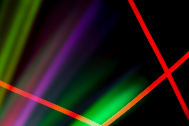 Red neon lines over the colorful laser light on dark background Free Photo