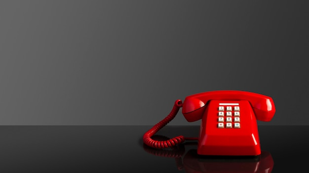 Red old vintage telephone on black background Premium Photo
