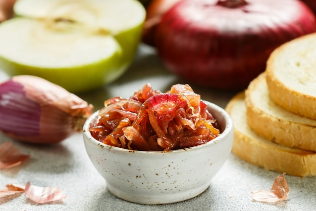 Red onion marmalade (jam, confiture, chutney) with green apple. delicious sauce. gourmet Premium Photo