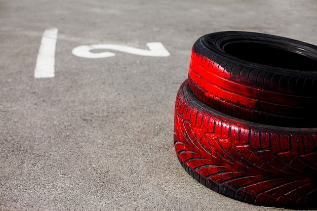 Red painted car tires on the road Free Photo