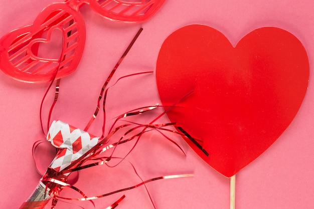 Red paper heart in decor Free Photo
