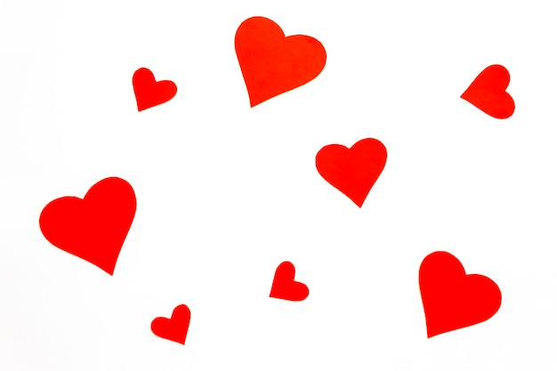 Red paper hearts on a white background Premium Photo