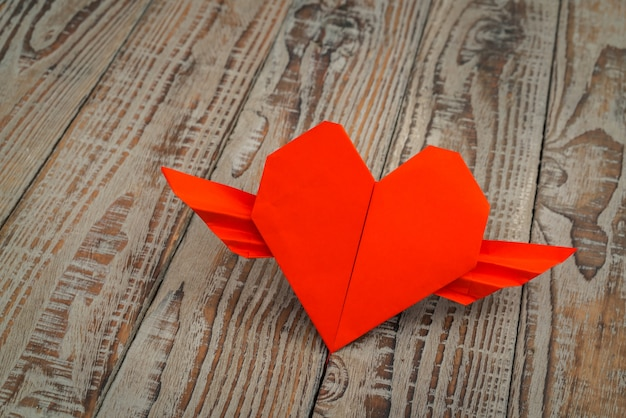 Red Paper Origami Heart With Wings On Wood Background Photo Free
