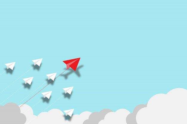 Red paper plane flying disrupt with white paper plane on blue background. lift and business creativity new idea to discovery innovation technology. Premium Photo