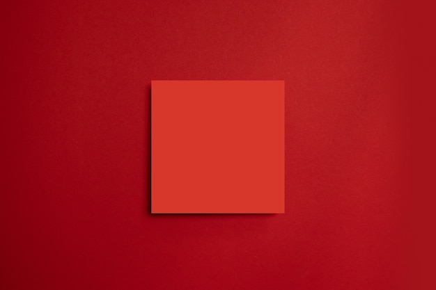 Red paper poster on a red background. all in one minimal style template. Premium Photo