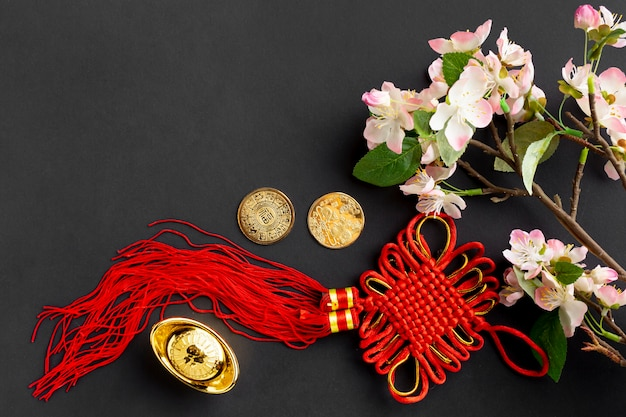 Red pendant and cherry blossom for chinese new year Free Photo