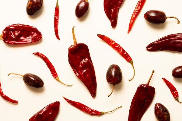 Red peppers on plain background Free Photo