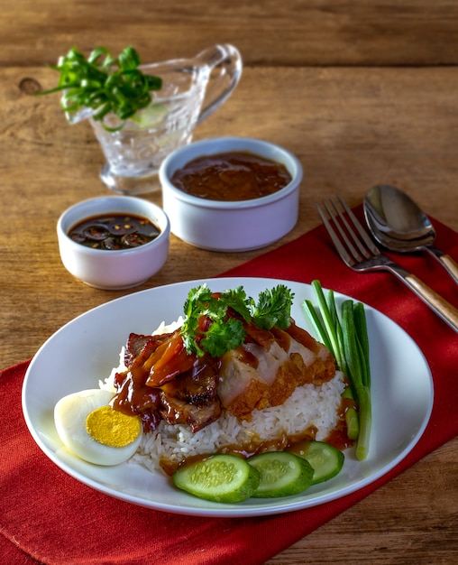 Red pork rice on a wood background Premium Photo