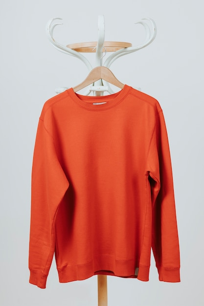Red pullover hanging Free Photo