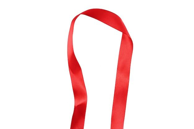 Дуга из красной ленты, разделяющая пустое пространство Premium Фотографии