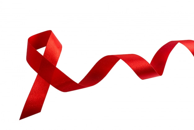 Red ribbon symbol bow color raising awareness on people living with tumor breast cancer isolated Premium Photo
