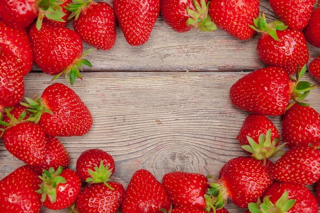 Red ripe strawberries on wooden table close up Premium Photo