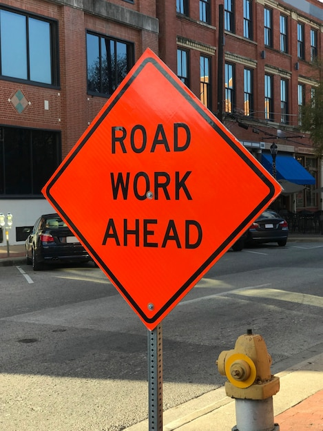 Red road works construction sign Free Photo