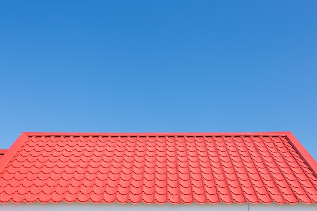 Red roof with blue sky background Premium Photo