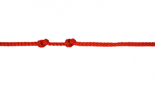 Red rope with knot isolated on  white background Premium Photo