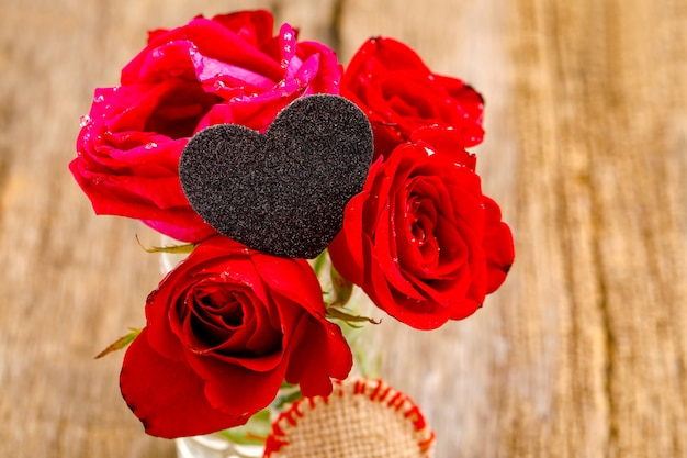Red rose bunch with little heart shape. valentine or women day concept Premium Photo