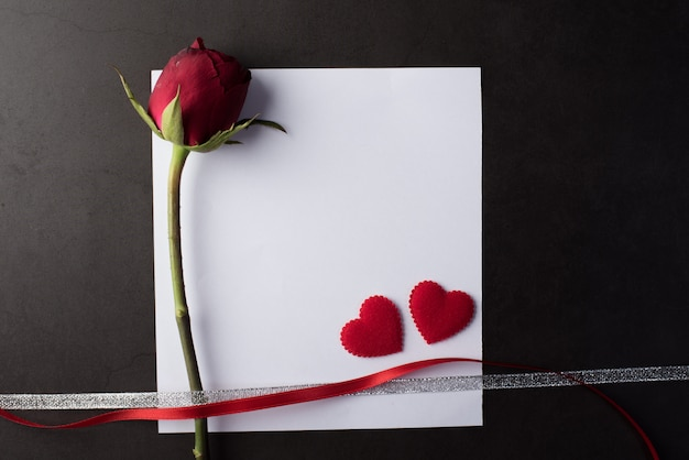Red rose with white card Free Photo
