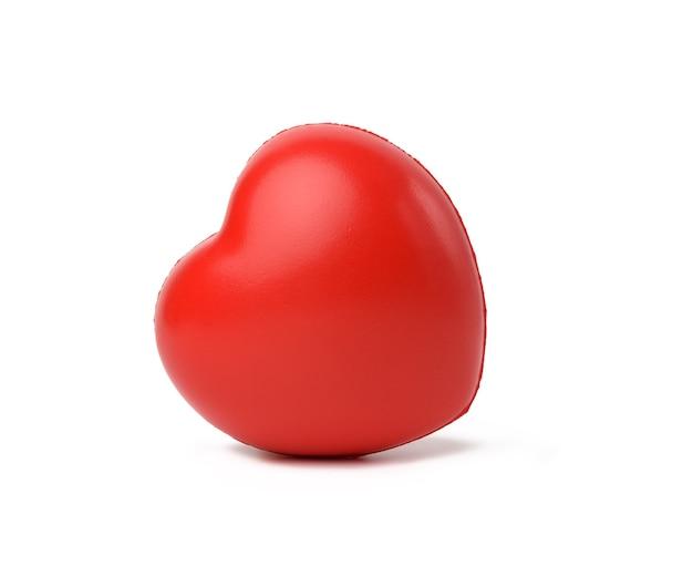 Красное резиновое сердце, изолированные на белом фоне, крупным планом Premium Фотографии