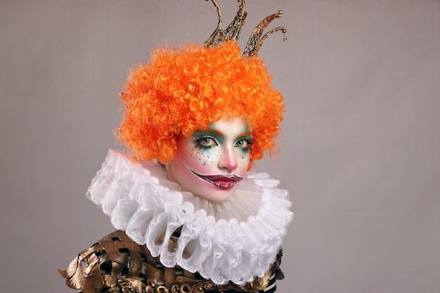Red sad clown . Premium Photo