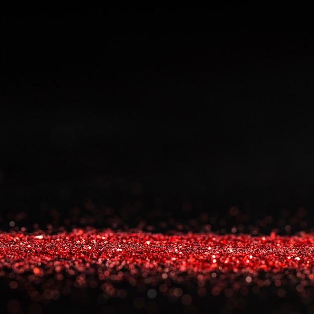Glitter rosso scintillante con spazio di copia Foto Gratuite