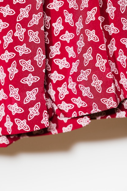 Red skirt with white details close-up Free Photo