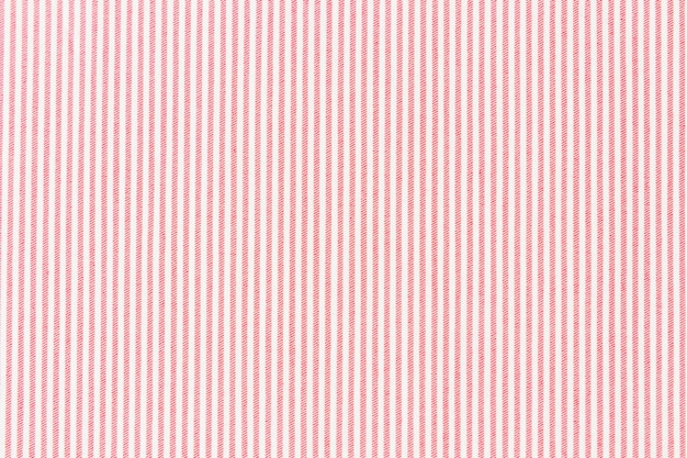 Red striped line on white fabric textured backdrop Free Photo