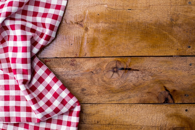 Red table cloth on wooden background Premium Photo