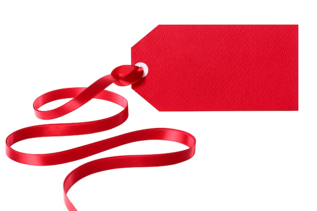 Red tag with a red ribbon Free Photo