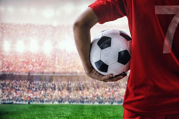 Красный футболист команды на стадионе Premium Фотографии
