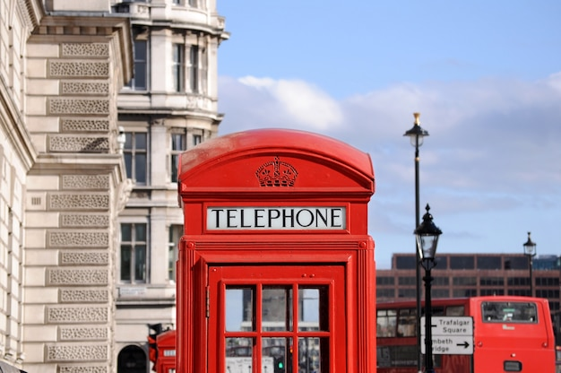 Red telephone box and double decker bus in london Free Photo