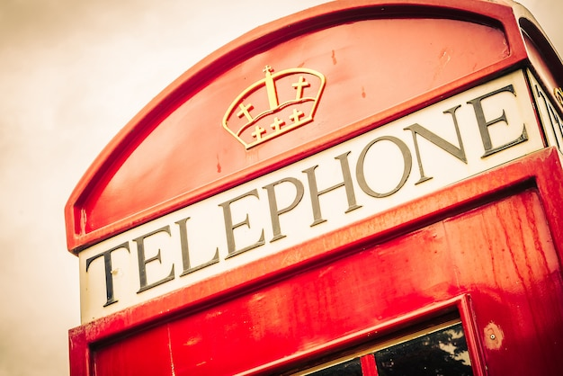 Red telephone box london style - vintage filter Free Photo