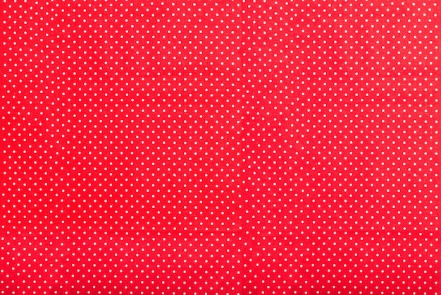 Red texture with white dots Premium Photo