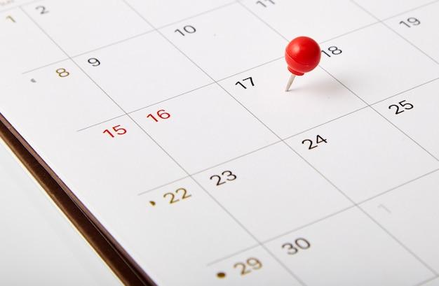 Red thumbtack tax day Premium Photo