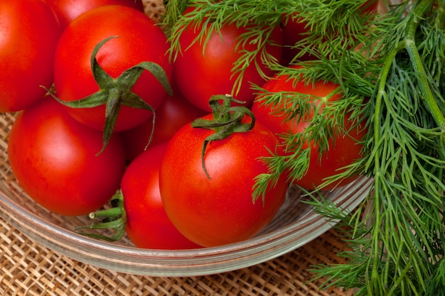 Red tomatoes and dill Premium Photo
