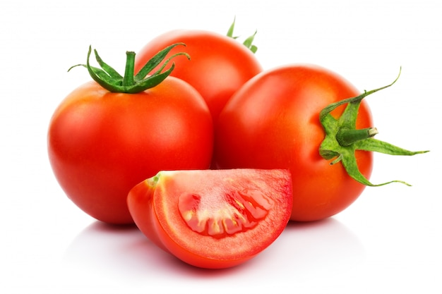 Red tomatoes with cut isolated on white Premium Photo