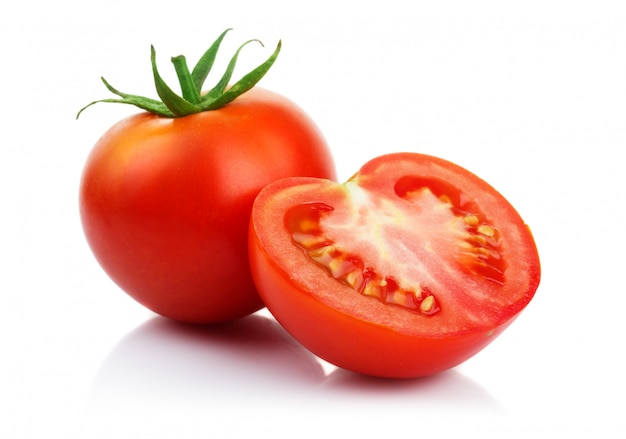 Red tomatoes with cut isolated on white | Premium Photo