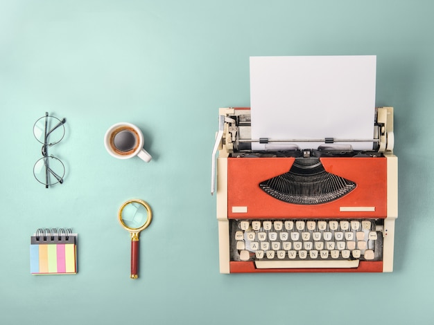 Red typewriter and  coffee (square format) Premium Photo
