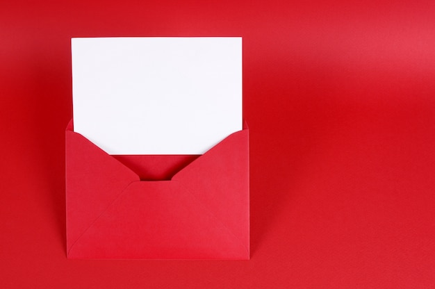 Red valentine envelope with a card Free Photo
