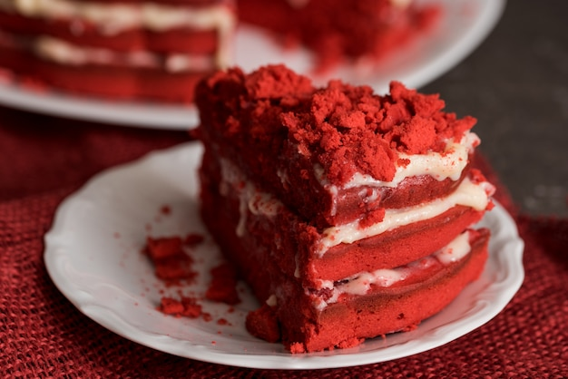 Red velvet cake canvas napkin on a concrete dark gray background Premium Photo
