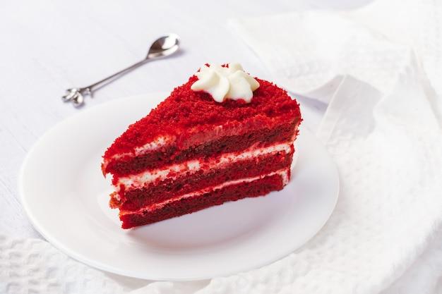 Red velvet cake sliced in piece on white plate Premium Photo